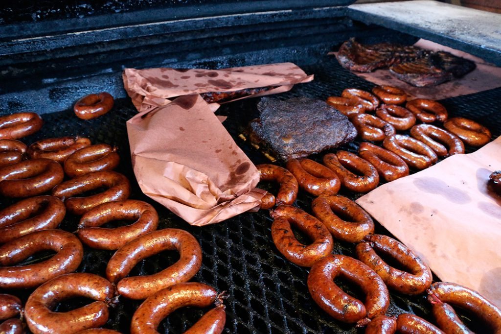 Photo of meats cooking at Hays County Bar-B-Que
